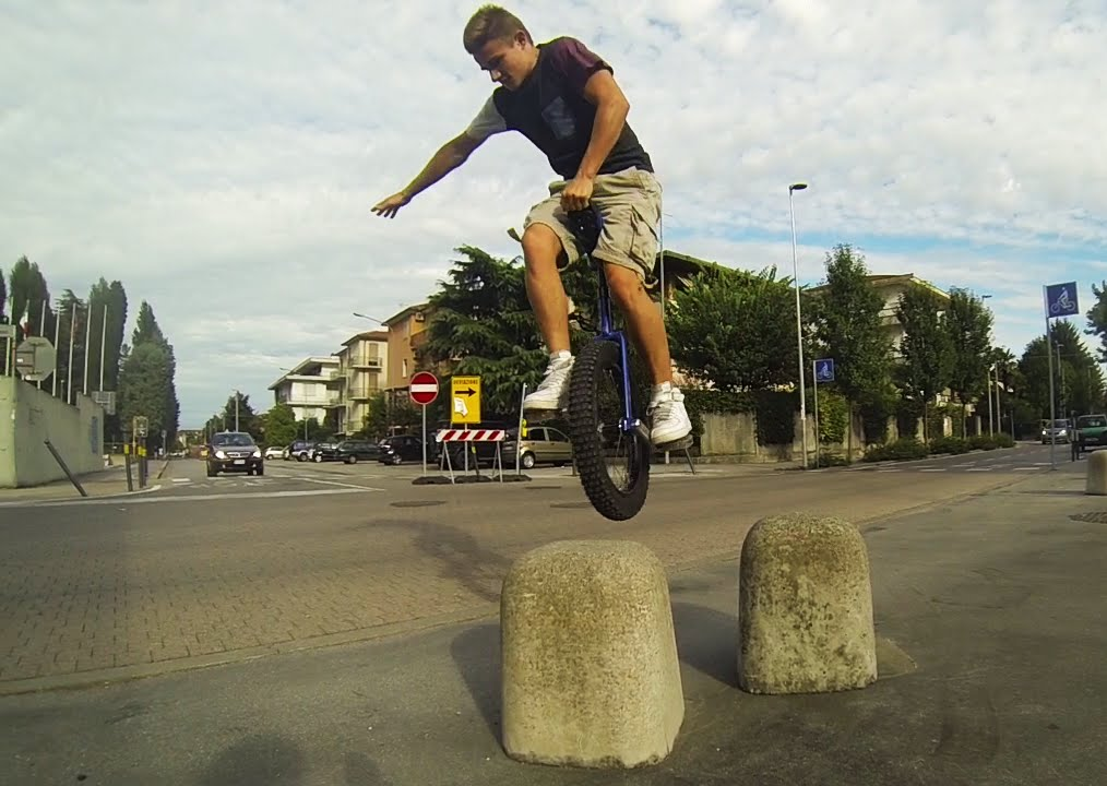 Guy fdoing urban freestyling on a unicycle